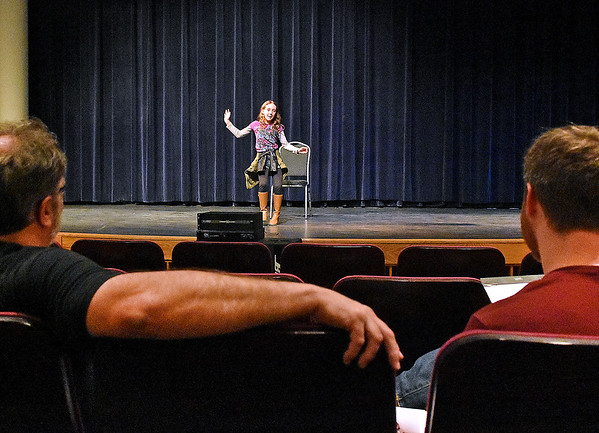 (Brad Davis/The Register-Herald) Theatre West Virginia's Dan Henthorn, left, and Jason Adkins watch as nine-year-old Fayetteville resident Bailey Runyon auditions for a possible role in one of three upcoming productions this season, The Addams Family, Hatfields & McCoys and Ring of Fire, Saturday morning at Tamarack's H.C. Smith Theater.