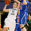 Brad Davis/The Register-Herald<br /> Wyoming East's Megan Davis tries to drive to the basket against tough defense from Morgantown's Shelby Boyle Thursday night at the Beckley-Raleigh County Convention Center.