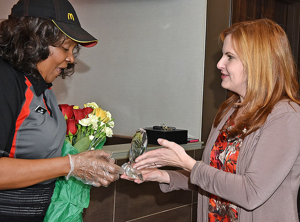 (Brad Davis/The Register-Herald) Harper Road McDonald's employee Sonia Smith has her award presented to her by human resources consultant Janice Zvaleny, right, after being named Crew Person of the Year for the company's Pittsburgh region during a suprise party Thursday afternoon.