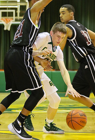 Greenbrier East's Seth Brown is stonewalled by Bluefield defender Dominick Taxley as he tries to drive to the basket Friday night in Fairlea.