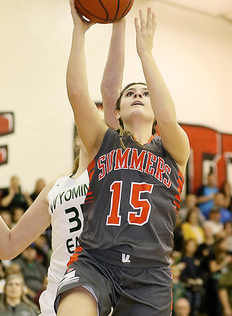 (Brad Davis/The Register-Herald) Summers County's Morgan Miller drives to the basket Thursday night in Glen Daniel.