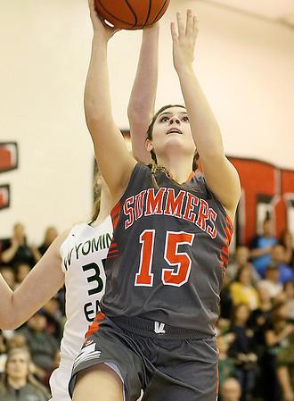 (Brad Davis/The Register-Herald) Summers County's Morgan Miller drives to the basket Thursday night in Glen Daniel.