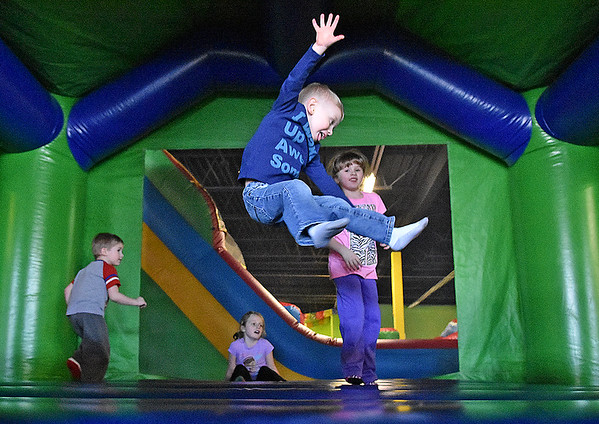 Three-year-old Jaxson Lewis (front) gets big air as he and fellow youngters (from left) Derick Shawver, 3, Payton Bailey, 7, and Kaitlyn Shawver, 5, bounce around at Jump Zone Thursday afternoon. With school closed again in several counties, area families used the free time to take their kids to the Beckley Plaza business to burn off some energy.