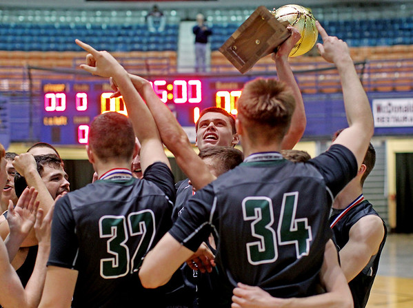 Wyoming East players celebrate with the Class AA Boys Championship trophy after defeating Robert C. Byrd in two-overtimes  at the Big Atlantic Classic Saturday in Beckley.