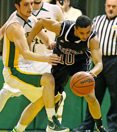 Brad Davis/The Register-Herald<br /> Bluefield's Jeremy Thompson wins the battle for a loose ball with Greenbrier East's Caleb Ward Friday night in Fairlea.