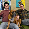 (Brad Davis/The Register-Herald) Co-owners Jamie Smith, left, and Jason Lockart pose for photos with unofficial mascot Nico inside Kid in the Background Multimedia Factory at their 105 Prince Street location February 17.