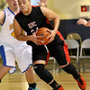 Greater Beckley Christian's Anthony Helton drives past Van's Greg Lail during the class A championship game Saturday night at the Beckley-Raleigh County Convention Center.