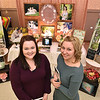 (Brad Davis/The Register-Herald) Photographer Melissa Kincaid, left, and assistant Shay Bennett pose for a quick photo as they show off their wedding and portrait photography booth during the Bridal, Prom and Special Occasions Fair Saturday afternoon at the Beckley-Raleigh County Convention Center.