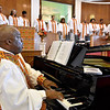 (Brad Davis/The Register-Herald) Minister of Music Quincy Madison leads the choir on piano during a Black History Month celebration at Central Baptist Church Sunday afternoon.
