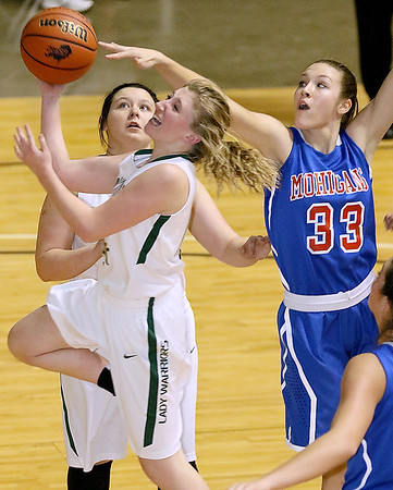 Brad Davis/The Register-Herald<br /> Morgantown's Lydia Adrian gets enough of a piece of the ball to stop Wyoming East's Misa Quesenberry from scoring Thursday night at the Beckley-Raleigh County Convention Center.