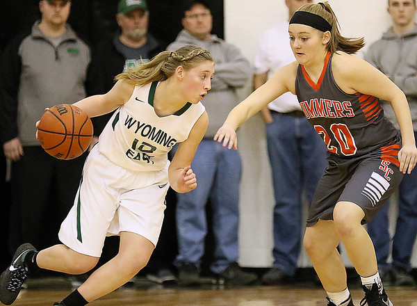 (Brad Davis/The Register-Herald) Wyoming East's Misa Quesenberry looks for a lane as Summers County's Tiffani Cline defends Thursday night in Glen Daniel.