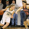 (Brad Davis/The Register-Herald) Wyoming East's Misa Quesenberry looks for a lane as Summers County's Tiffani Cline defends Thursday night in Glen Daniel.