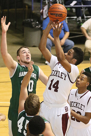 Woodrow Wilson's Malyk Fowlkes drives and scores against Hampshire Friday night at the Beckley-Raleigh County Convention Center.
