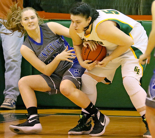 (Brad Davis/The Register-Herald) Greenbrier East's Piper Nunley fights for a loose ball with Princeton's Autumn Bradley Friday night in Fairlea.