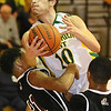Greenbrier East's Caleb Ward crashes into Bluefield's Dominick Taxley as he tries to score Friday night in Fairlea.