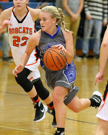 Brad Davis/The Register-Herald<br /> Princeton's Danielle Hall avoids Summers County defenders as she hustles up the court Saturday afternoon in Hinton.