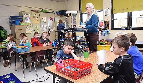 Rick Barbero/The Register-Herald<br /> Karen Greer instucting her kindergarten class after returning back to school from Christmas break. Children returned back to school Tuesday morning after Christmas break a little sluggish and with some anxiety explained, Crescent Elementary School principal Theresa Lewis. The children are just out of their routine bit because the past 13 days they've been staying up later, sleeping later and staying in their pajamas longer. Lewis said we just greet them with a smile and give them a big warm hug and by mid day they are back to normal.