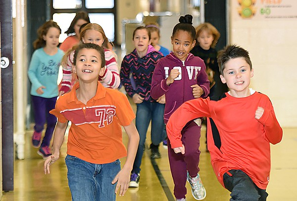 Rick Barbero/The Register-Herald<br /> Third grade students run laps around the gym in Jane Sutphin's Physical Education class helping the childen to get a little boost of emergy after returning from Christmas break. Children returned back to school Tuesday morning a little sluggish and with some anxiety explained, Crescent Elementary School principal Theresa Lewis. The children are just out of their routine bit because the past 13 days they've been staying up later, sleeping later and staying in their pajamas longer. Lewis said we just greet them with a smile and give them a big warm hug and by mid day they are back to normal.