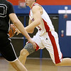 Brad Davis/The Register-Herald<br /> Independence's Tyler Haga looks for a lane during the Patriots' win over Liberty Saturday night in Coal City.