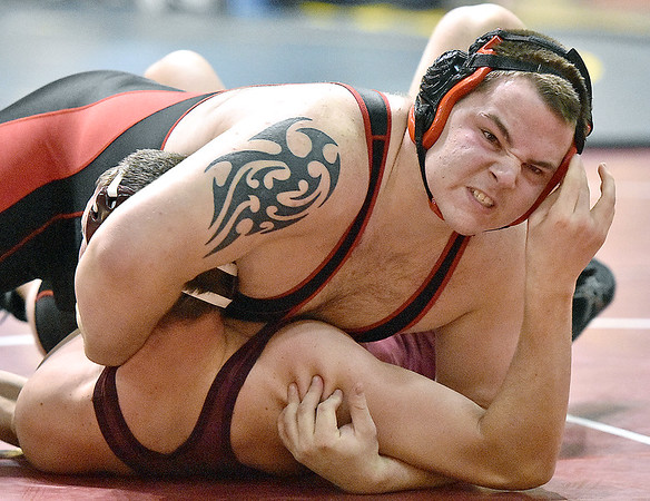 Brad Davis/The Register-Herald<br /> Oak Hill's Tate Wykle takes on Woodrow Wilson's Caleb Persinger in a 285-pound matchup Friday afternoon at the Beckley-Raleigh County Convention Center. Wykle would go on to win the match.