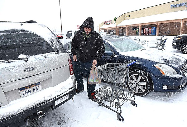 Jermaine Edwards, of Beckley, loads some groceries in his car at Krogers off Eisenhower Drive in Beckley Friday morning.