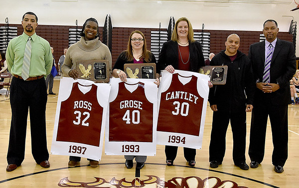 Brad Davis/The Register-Herald<br /> Former Lady Eagles players (from left) Natasha Ross (now Merrell), Kim Grose (now Goodson) and Kim Cantley look to the crowd as the three are honored with an induction into the Woodrow Wilson Girls Basketball Hall of Fame during the halftime break of a game against Shady Spring Friday night.