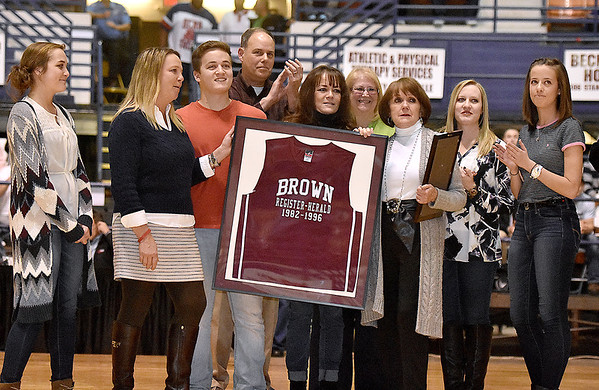 Brad Davis/The Register-Herald<br /> Family of the late Scott Brown accept his plaque during Woodrow Wilson's Boys Basketball Hall of Fame induction ceremony at the halftime break of the Flying Eagles' game against Bluefield Saturday night at the Beckley-Raleigh County Convention Center.