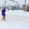 Brad Davis/The Register-Herald<br /> Beckley resident Fred Pierce trudges through Friday's snowstorm along Robert C. Byrd drive on the edge of the roadway, the only place to get any real footing, on his way back to his South Oakwood Avenue home.