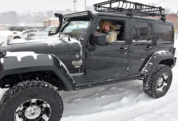 Brad Davis/The Register-Herald<br /> If you needed to travel during Friday's winter blitz, you needed one of these, as Beckley resident Sonny Peterson had in his Jeep Wrangler.