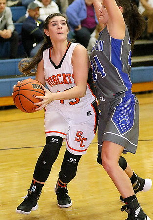 Brad Davis/The Register-Herald<br /> Summers County's Morgan Miller drives to the basket as Princeton's Kaleigh Barker defends Saturday afternoon in Hinton.