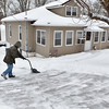 Brad Davis/The Register-Herald<br /> Beckley resident Terri Smith works to keep the driveway of her Edgewood Drive home clear, or at least make it easier to clear again once a supposed second wave hits, during a lull in Friday's winter weather.