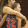 Brad Davis/The Register-Herald<br /> Summers County's Whittney Justice is embraced by teammate Jordan Sigmon as she's congratulated by the her teammates after scoring her 1,000th career point during the Lady Bobcats' win over the Lady Eagles Wednesday night in Beckley.