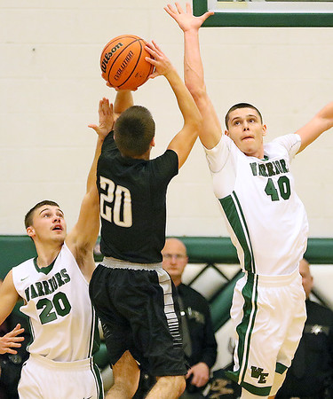 Brad Davis/The Register-Herald<br /> Wyoming East's David Carte, right, and R.J. Foldon scramble to try and block Westside's Shane Jenkins' shot during the Warriors' win over the Renegades Friday night in New Richmond.