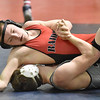 Brad Davis/The Register-Herald<br /> Liberty's Alex Williams takes on North Marion's Kyle Elliott in a 152-pound weight class matchup Friday afternoon at the Beckley-Raleigh County Convention Center. Elliott would go on to win the match.