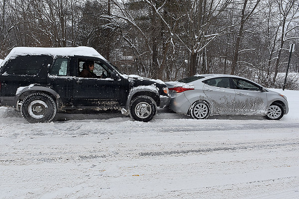 Brad Davis/The Register-Herald<br /> Beckley resident Jeff Smith, left, uses his bumper to help out standed motorist Samantha Page as he pushes her along Fayette Street Saturday afternoon.