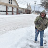 Brad Davis/The Register-Herald<br /> Beckley resident Joe Hanshaw trudges along second street as he takes advantage of a lull in the snowfall to walk to the store Friday afternoon.