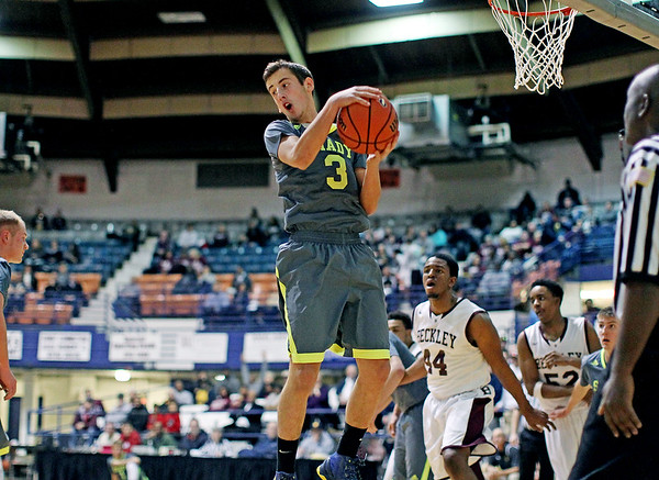 Shady Spring's (3) grabs a rebound during the first half of their basketball game against Woodrow Wilson in Beckley.