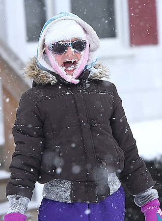 Rick Barbero/The Register-Herald<br /> Shannon Barlett, 11, reacts after her sister, Amber Barlett, 11, dumped a load off snow on her in thier front yard on Westwood Drive Friday morning.