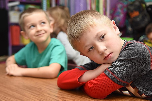 Rick Barbero/The Register-Herald<br /> Cooper Phillips, kindergarten student in Karen Greer's class, rests his head on his shoulder after returning back to school from Christmas break. Children returned back to school Tuesday morning little sluggish and with some anxiety explained, Crescent Elementary School principal Theresa Lewis. The children are just out of their routine bit because the past 13 days they've been staying up later, sleeping later and staying in their pajamas longer. Lewis said we just greet them with a smile and give them a big warm hug and by mid day they are back to normal.
