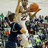 Woodrow Wilson's Isaiah Francis (22) goes up for a layup over a Spring Valley player during the first quarter of their basketball game Thursday in Beckley.