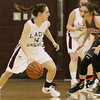 Brad Davis/The Register-Herald<br /> Woodrow Wilson's Rebekah Cook looks for an open teammate as Summers County's Hannah Taylor defends during the Lady Eagles' loss to the Lady Bobcats Wednesday night in Beckley.