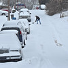 Brad Davis/The Register-Herald<br /> A resident works to keep his driveway access clear along Edgewood Drive in Beckley during Friday's wave of winter weather.