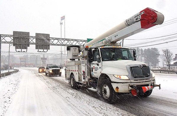 Rick Barbero/The Register-Herald<br /> Appalachian Power trucks getting ready power outages in the Beckley area form the Winter Storm that hit the area Friday morning.