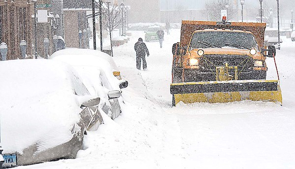 Rick Barbero/The Register-Herald<br /> Beckley Board of Public Works plows snow along side cars that are buried up on Neville Street in Beckley, WV, Saturday morning. The winter Storm Jonas blasted the area with approximately 16 inches of snow.