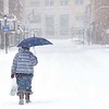 Rick Barbero/The Register-Herald<br /> Sandra Horton, of Beckley, WV, walks down the deserted Neville Street in Beckley Saturday morning The winter Storm Jonas blasted the area with approximately 16 inches of snow.