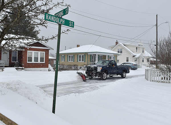 Brad Davis/The Register-Herald<br /> Anyone who owned or operated a snow plow stayed busy Friday as the first wave of a massive winter storm hit the Beckley area during the early morning hours.