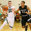 Brad Davis/The Register-Herald<br /> Wyoming East's Logan Blankenship drives as Westside's Tre Colucci defends during the Warriors' win over the Renegades Friday night in New Richmond.