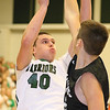 Brad Davis/The Register-Herald<br /> Wyoming East's David Carte drives to the basket as Westside's Cory Hatfield defends during the Warriors' win over the Renegades Friday night in New Richmond.