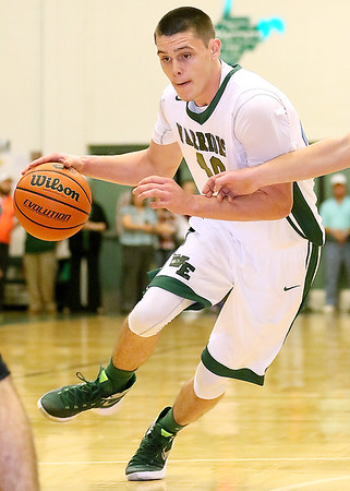 Brad Davis/The Register-Herald<br /> Wyoming East's David Carte drives during the Warriors' win over the Renegades Friday night in New Richmond.