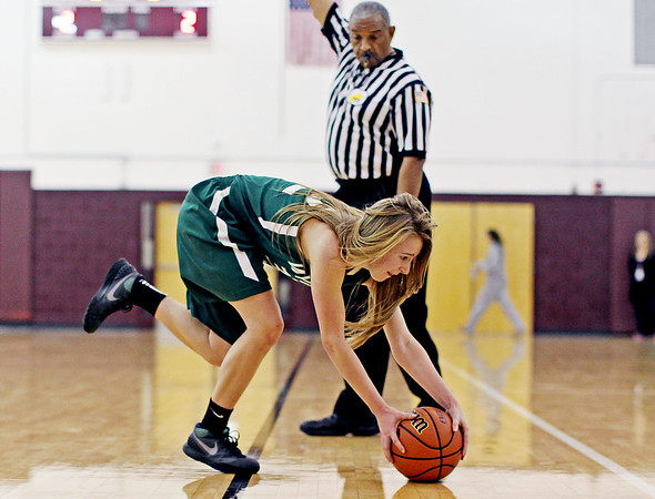 Wyoming East's Gabby Lapardus chases a ball down as it rolls out of bounds during their basketball game against Woodrow Wilson in Beckley on Monday.